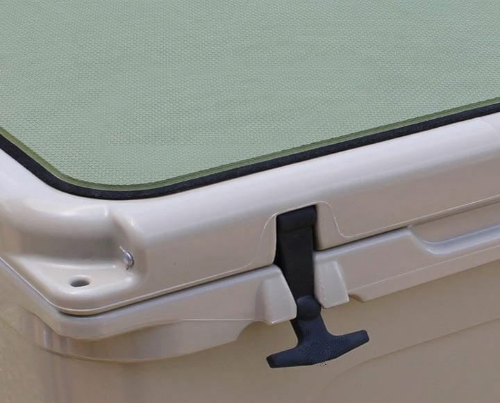 green foam cooler pad on top of cooler