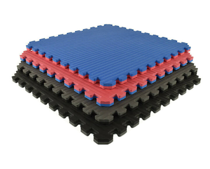 pile of interlocking sports foam mats