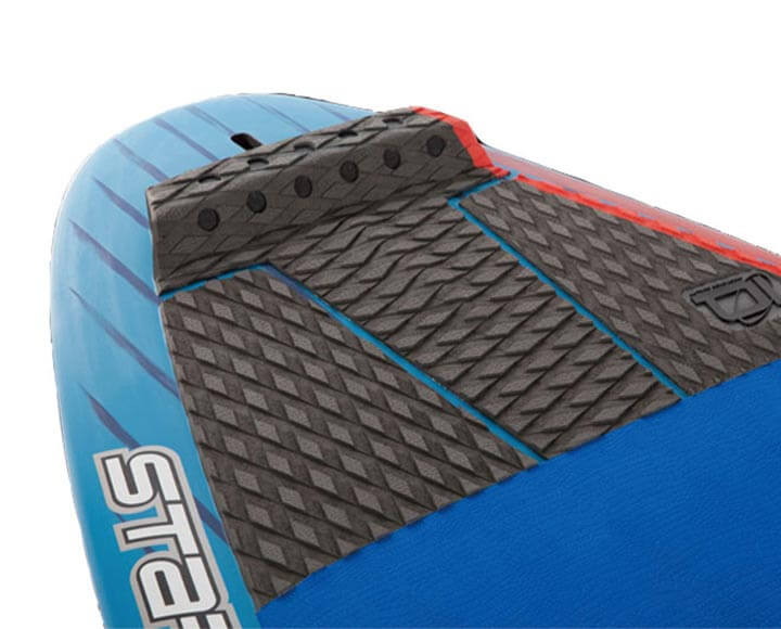Black surf traction pad in use on surfboard