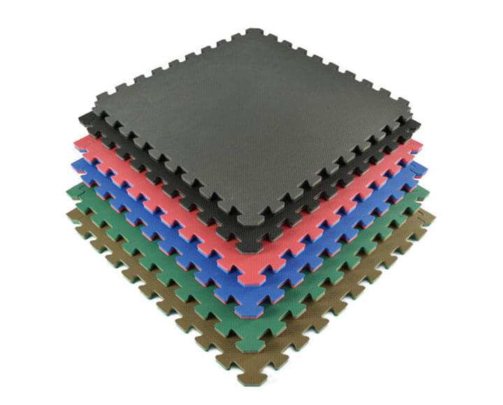 foam puzzle mats piled up in various colors