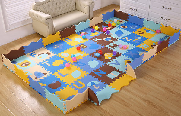 Kids play puzzle mats